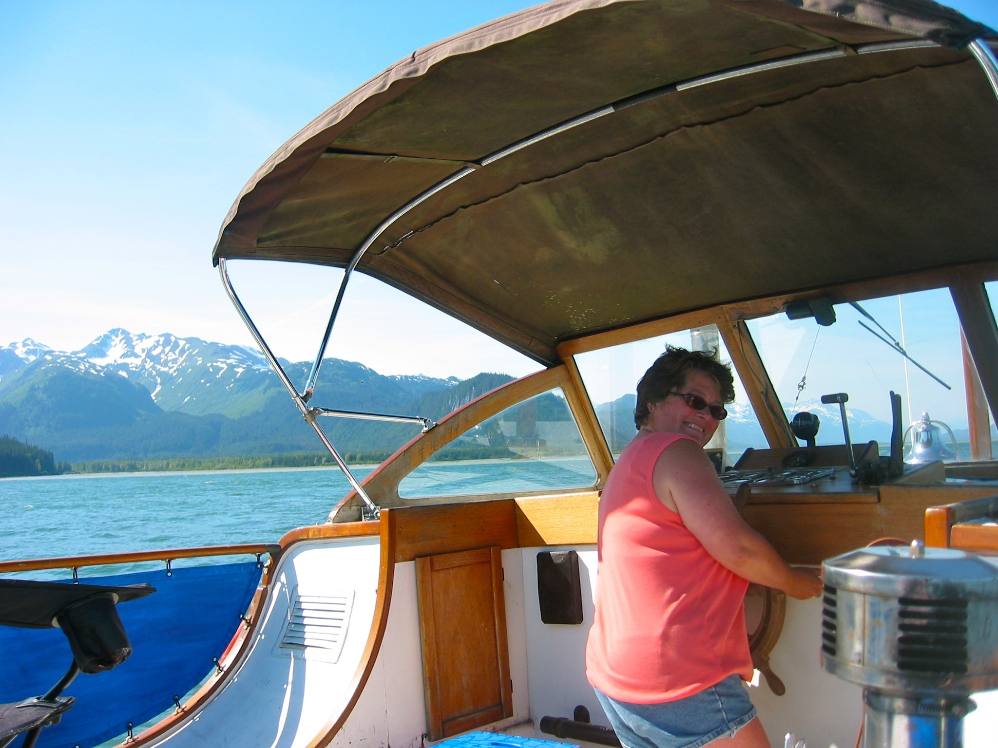 I am glad to have my clothes on, the author Dawn kostelnik at the helm of the Audrey Eleanor motoring from Juneau Alaska to Haines Alaska